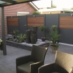 Clôture alternance de bois et d'aluminium pour un look résolument moderne